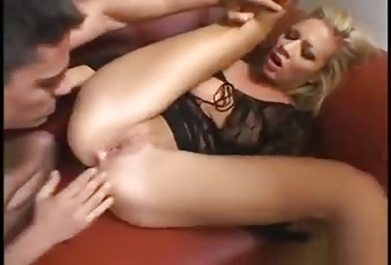 Blonde chick is fucking on the red couch