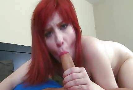 Redhead is sucking his dick