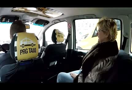 Mature blonde woman in the car