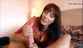 Red-haired mom whisks a long penis