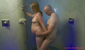 He closes the pregnant chick in the shower
