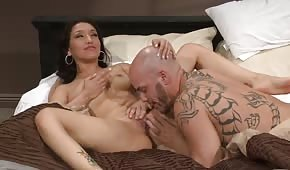 Brunette rides a bald guy