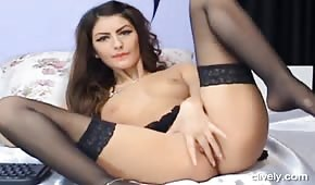 The cane in stockings is playing with her finger