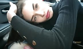 A cute babe gets a blow job in the car