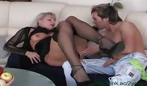 Horny mother rubs her son