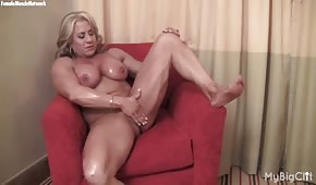 The muscular bitch is giving her finger