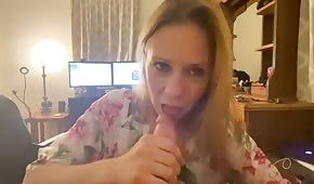 The wife takes a dick in her mouth