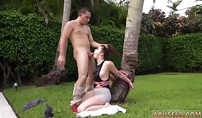 He pushes his cock into her friend's mouth under the palm tree