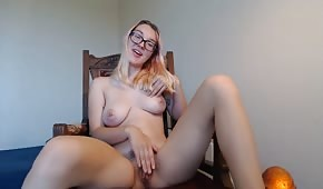 The eyeglass is playing with her tits