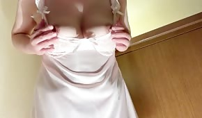 Busty girl in a nightgown