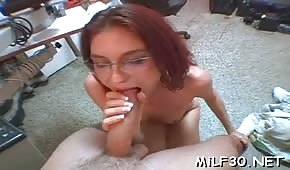 Red-haired lady doctor sucks a long cock