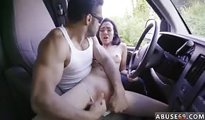 He plays with her tight pussy in the car